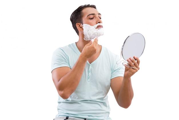 Rasatura bella dell'uomo isolata su bianco Foto Premium