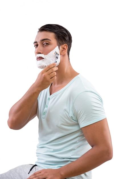 Rasatura bella dell'uomo isolata su fondo bianco Foto Premium