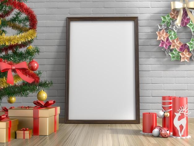 Regali dorati, albero di natale, candela e cornice vuota in salotto Foto Premium