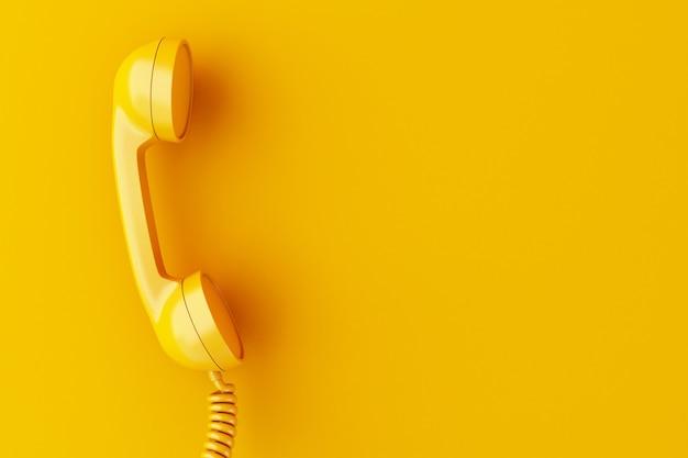 Ricevitore del telefono 3d su sfondo giallo. Foto Premium