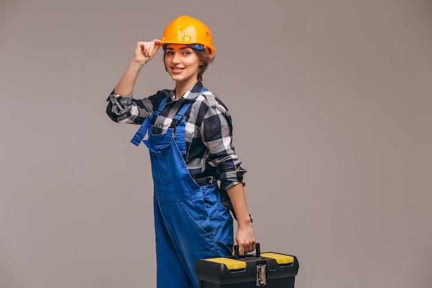 Riparatore di donna in uniforme con cassetta degli attrezzi Foto Gratuite