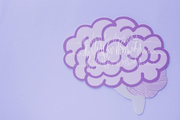 Ritaglio di carta cerebrale per encefalografia, consapevolezza dell'epilessia, disturbo convulsivo, concetto di salute mentale Foto Premium