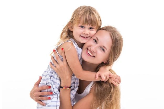 Ritratto bella caucasica madre e figlia Foto Premium