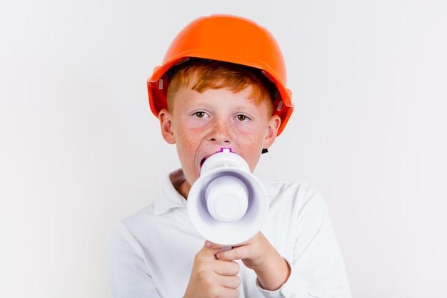 Ritratto di bambino carino con casco Foto Gratuite