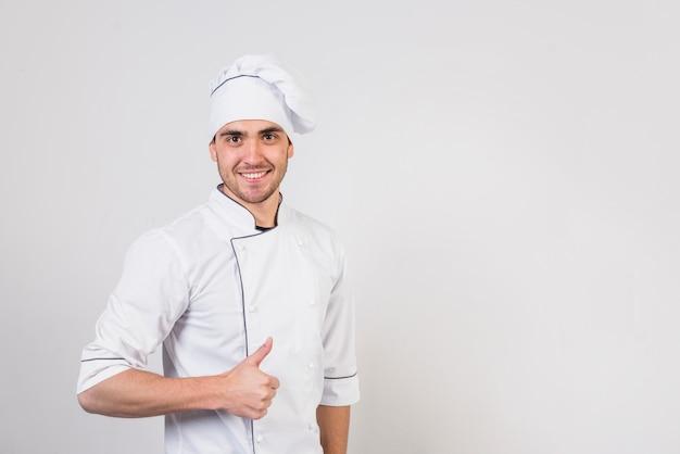 Ritratto di chef facendo gustoso gesto Foto Gratuite