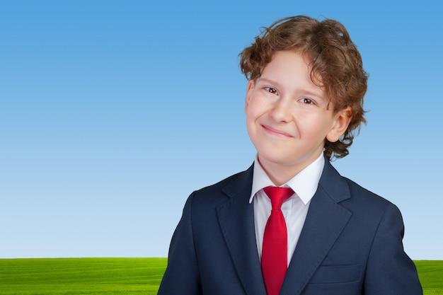 Ritratto di un uomo d'affari bambino Foto Premium