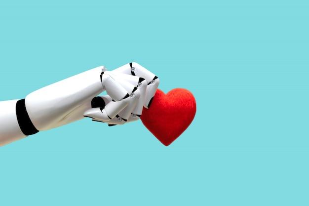 Robot mano che tiene il cuore tecnologia medica potenza futura Foto Premium