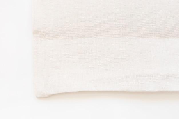 Sacchetto della spesa del panno del tessuto della tela della borsa di totalizzatore su fondo bianco Foto Gratuite