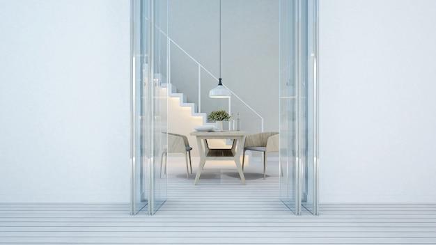 Sala da pranzo e balcone tono bianco in casa o in condominio Foto Premium