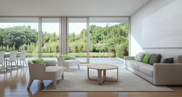 Sala da pranzo e soggiorno di casa di lusso con vista lago in design ...