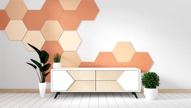 Scaffale della tv nella stanza vuota moderna con le piante sul fondo arancio delle mattonelle di esagono Foto Premium