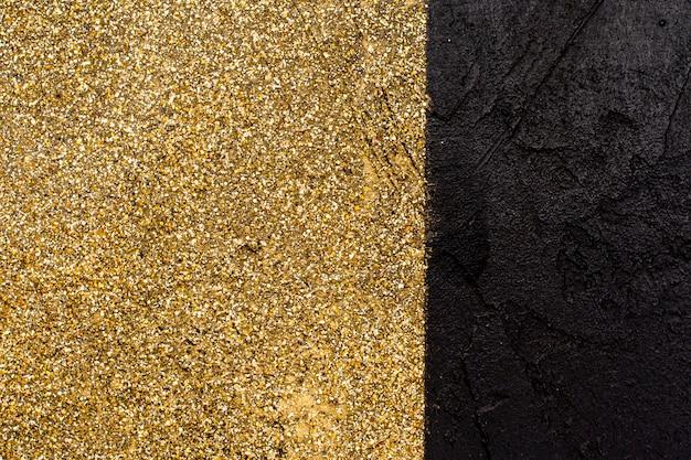 Scintillio dorato con il concetto di sfondo di ardesia Foto Gratuite
