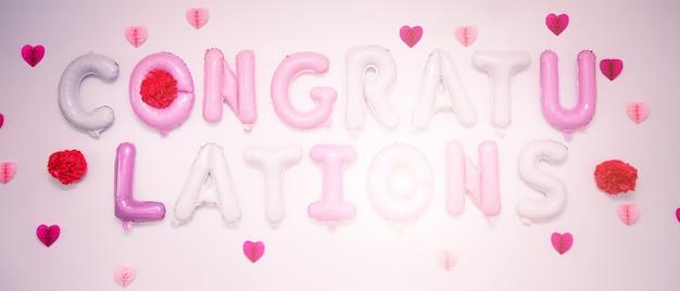 Segno di congratulazioni di palloncini di colore. Foto Premium