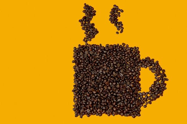 Semi a forma di tazza di caffè su uno sfondo giallo Foto Premium