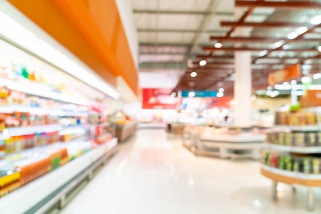 Sfocatura astratta in un supermercato Foto Premium