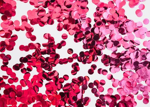Sfondo astratto con coriandoli rosa Foto Gratuite