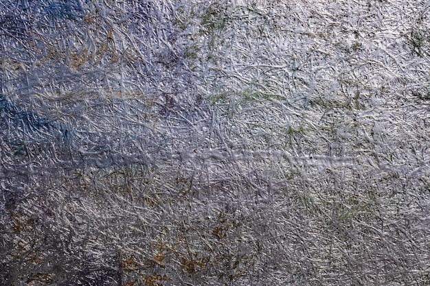 Sfondo astratto della superficie metallica di un conglomerato di materiali dipinti. Foto Premium