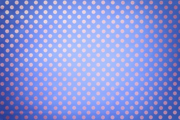 Sfondo azzurro da carta da imballaggio con un modello di primo piano d'argento a pois. Foto Premium