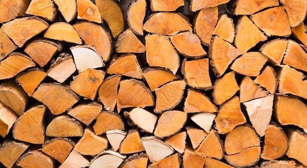 Sfondo del primo piano di legna da ardere tagliata Foto Premium
