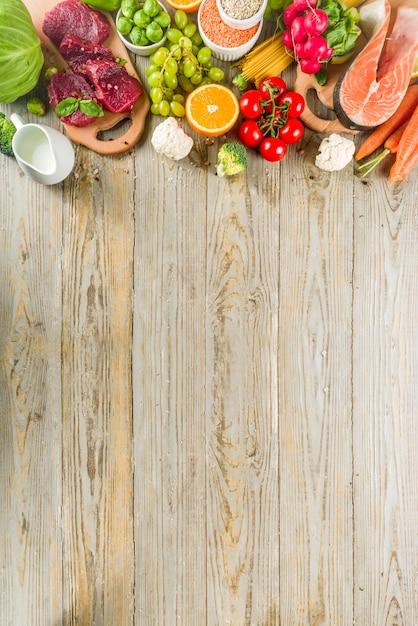 Sfondo di dieta flessibile, ingredienti alimentari, carne, mare e verdure Foto Premium