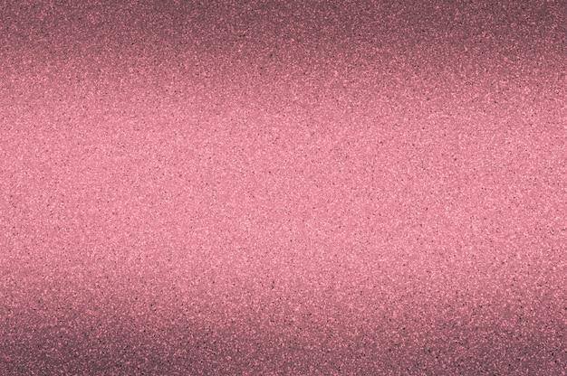 Sfondo di granito di colore rosso con piccoli punti. oscuramento dall'alto e dal basso. Foto Premium