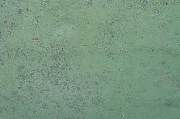 Sfondo di metallo verde. vernice versata. la struttura del metallo può essere usata come sfondo Foto Premium