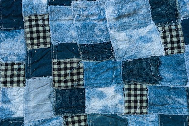 Sfondo di tessitura patchwork e texture filetto di tono blu
