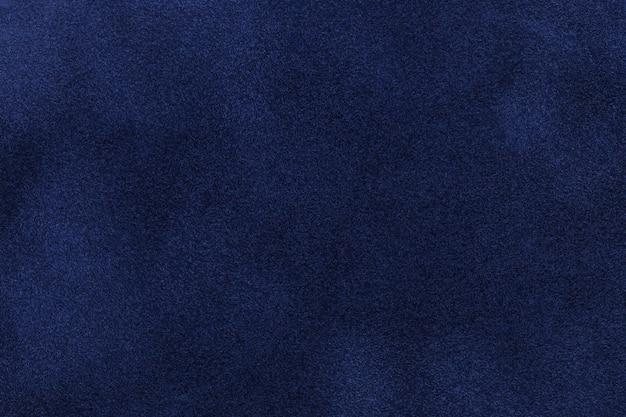 Sfondo di tessuto scamosciato blu scuro. trama velluto opaco in tessuto nabuk blu navy Foto Premium