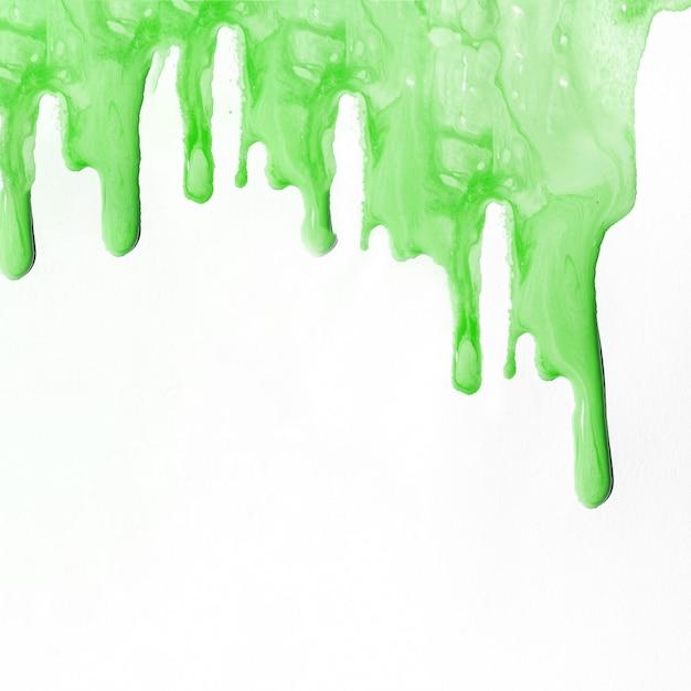 Sfondo di vernice liquida verde con copyspace Foto Gratuite