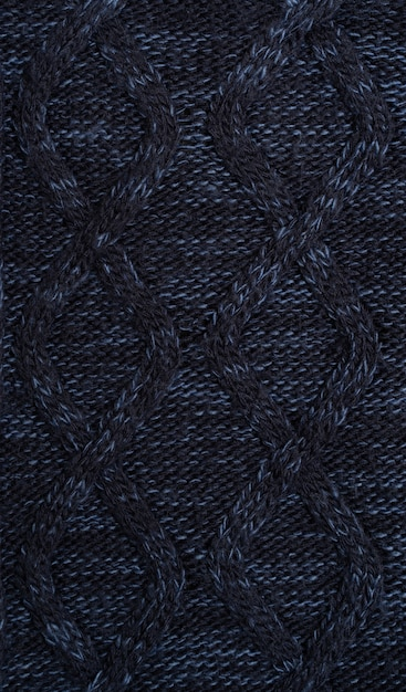 Sfondo di vestiti a maglia di lana calda blu scuro Foto Premium
