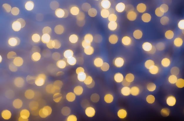 Sfondo festivo con luci bokeh. natale e capodanno Foto Premium