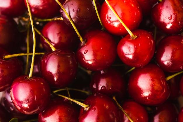 Sfondo fresco di deliziose ciliegie Foto Gratuite