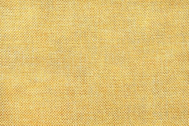 Sfondo giallo chiaro di tessuto insacchettamento denso Foto Premium