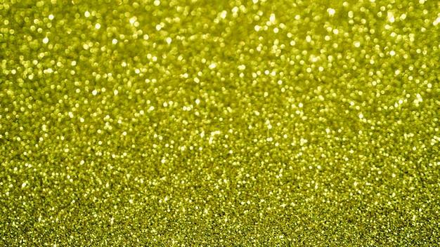 Sfondo glitter giallo vista dall'alto Foto Gratuite