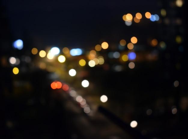 Sfondo glitter vintage luci. oro scuro e nero. defocused Foto Premium