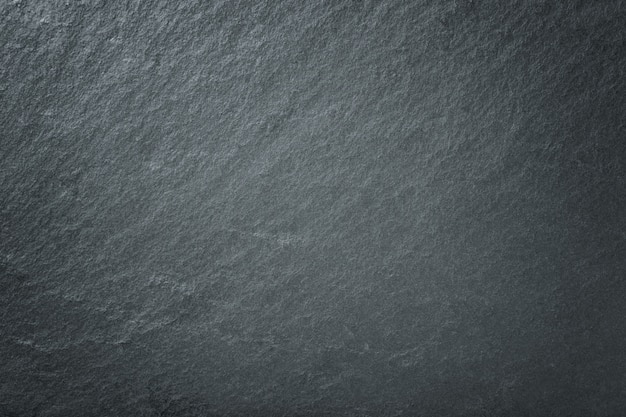 Sfondo grigio scuro di ardesia naturale. primo piano di pietra nera di texture. Foto Premium