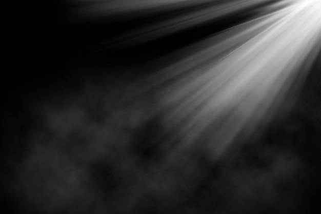 Sfondo grunge con riflettori che brilla in un'atmosfera affumicata Foto Gratuite