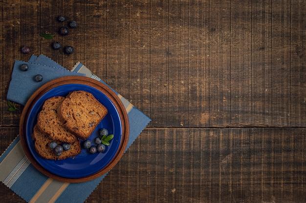 Sfondo in legno con delizioso spuntino Foto Gratuite