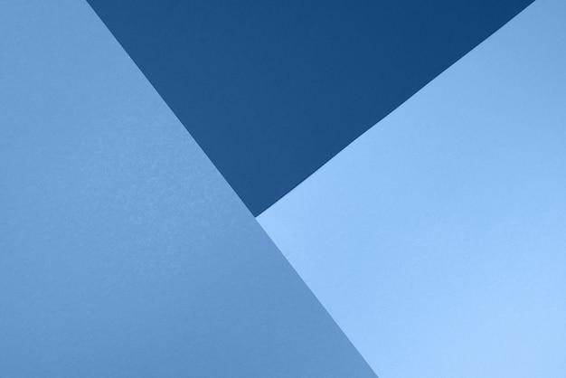 Sfondo nei colori blu alla moda. carta alla moda. vista dall'alto. concetto minimale. colore monocromatico alla moda Foto Premium
