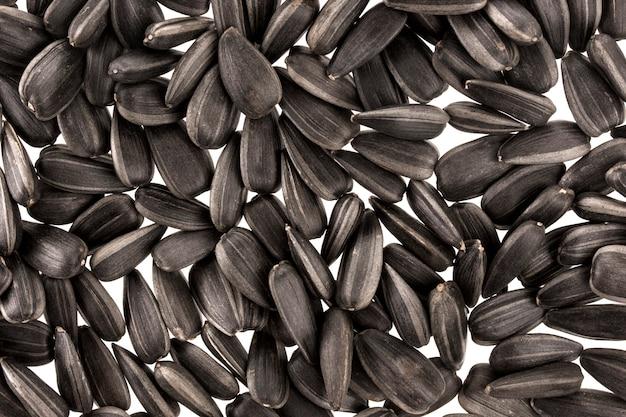 Sfondo nero semi di girasole Foto Premium