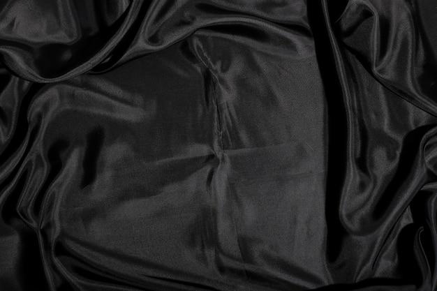 Sfondo nero trama del tessuto di seta Foto Gratuite