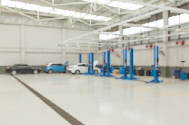 Sfondo sfocato del centro auto servizio automobilistico. Foto Premium