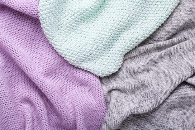 Sfondo trama di lana grigio, menta e lilla trama di tessuto all'uncinetto vista dall'alto copia spazio Foto Premium