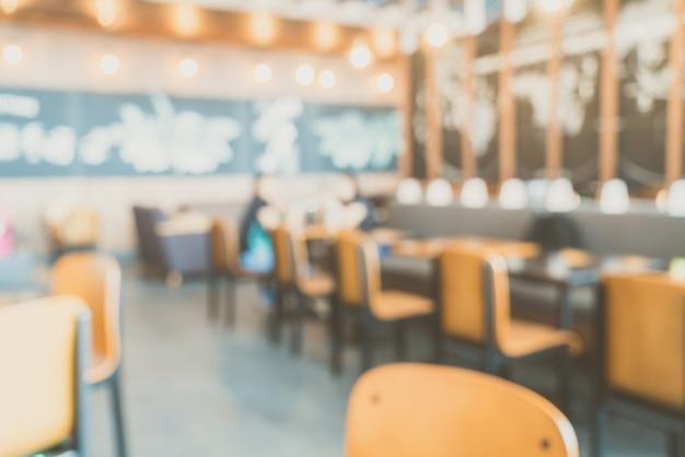 Sfuocatura astratta caffetteria interno Foto Gratuite