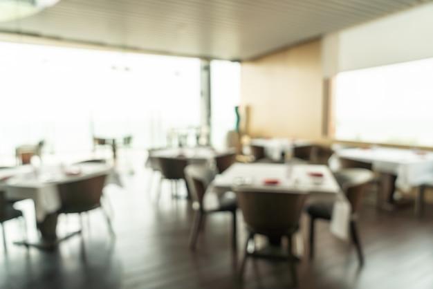 Sfuocatura astratta e buffet sfocato della prima colazione all'interno del ristorante dell'hotel come fondo vago Foto Premium