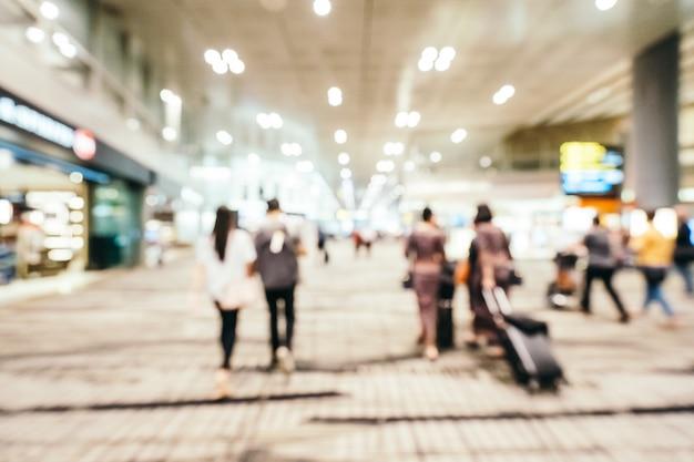 Sfuocatura astratta e interiore terminale del terminal dell'aeroporto di changi defocused Foto Gratuite