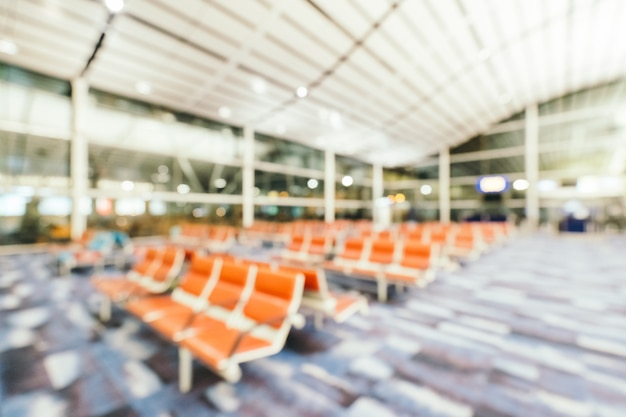 Sfuocatura astratta e interno defocused del terminale di aeroporto, fondo vago della foto Foto Gratuite
