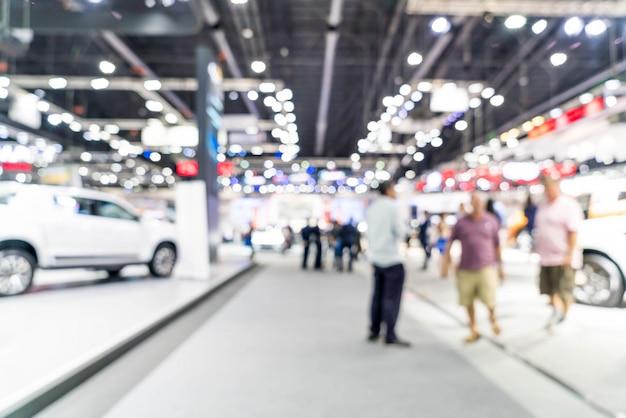 Sfuocatura astratta ed esposizione di manifestazione di mostra dell'automobile e dell'automobile defocused Foto Premium