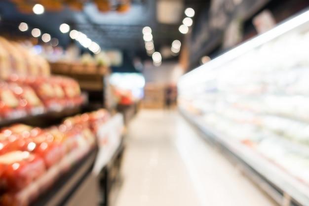 Sfuocatura astratta supermercato nel grande magazzino Foto Gratuite