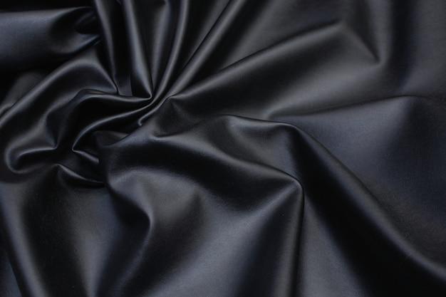 Similpelle nel disegno nero del fondo di struttura Foto Premium
